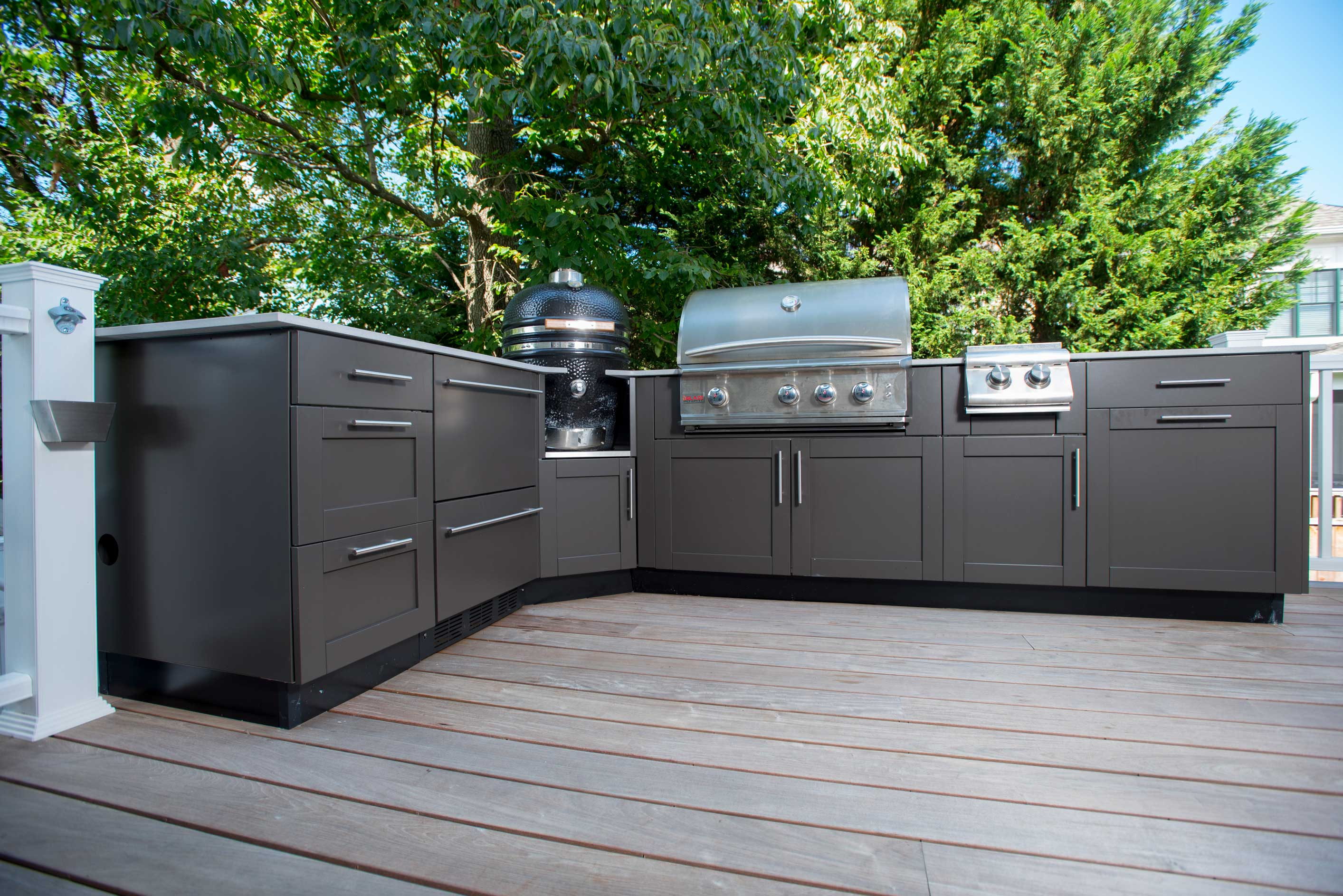 outdoor kitchen island the bbq island vs the outdoor kitchen genesis kitchens 10151